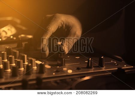 Dj Mixing Music And Moving Faders