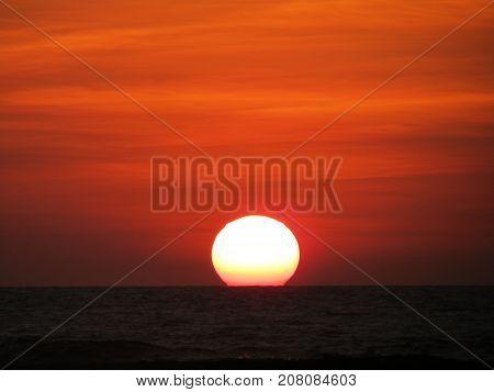 Red sunset over indian ocean in Sri Lanka
