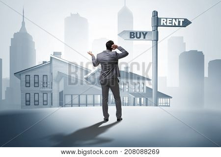 Businessman at crossroads between buying and renting