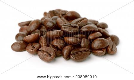Pile of roast coffee beans isolated on white