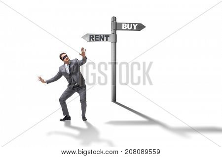 Businessman at crossroads betweem buying and renting on white