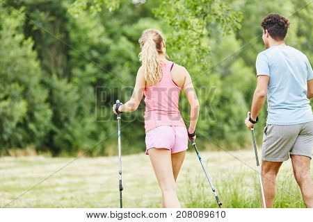 Nordic walking in the nature for fitness practice