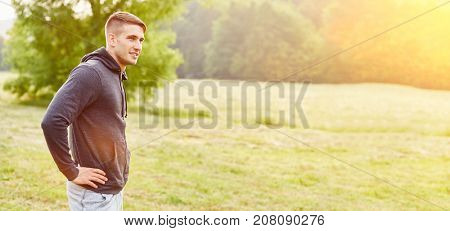 Teenager in summer in the nature standing pensive