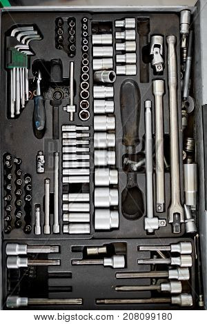 Tool box set containing a hammer, pliers, screwdriver, removable screwdriver heads and other
