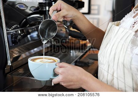 Close-up Hand Of Barista Making Latte Or Cappucino Coffee In Coffee Shop. Cafe Restaurant Service, F