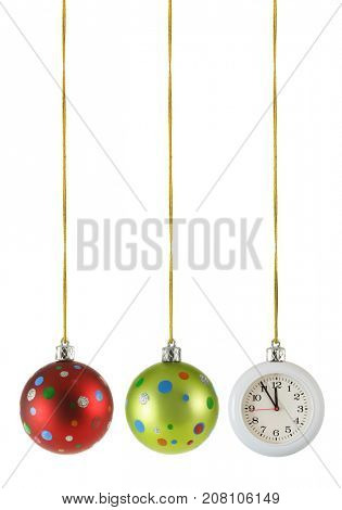 Christmas balls and hanging clock isolated over the white background