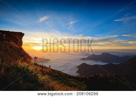 Tourist looking sunrise at Phu Chi Fa in Chiang rai Thailand