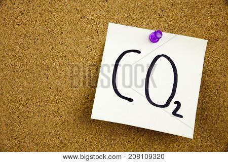 A Yellow Sticky Note Writing, Caption, Inscription Phrase Co2 In Black Ext On A Sticky Note Pinned T
