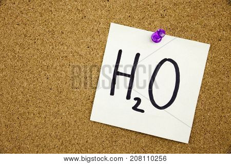A Yellow Sticky Note Writing, Caption, Inscription Phrase H2O In Black Ext On A Sticky Note Pinned T