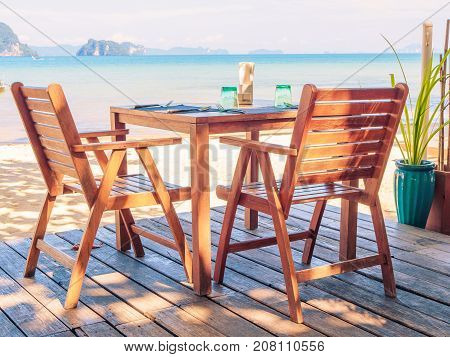 Dinner table on the beach with beautiful sea view background.