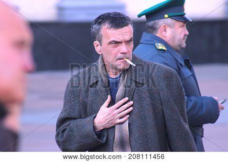 Zhytomyr Ukraine - August 15 2017: Old man smoking sigarette outdoor