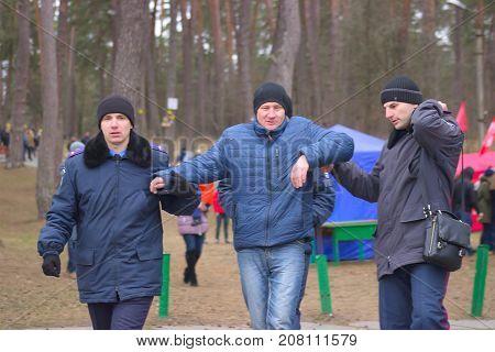 Zhytomyr Ukraine - January 19 2016: Police arrested drunked man at park