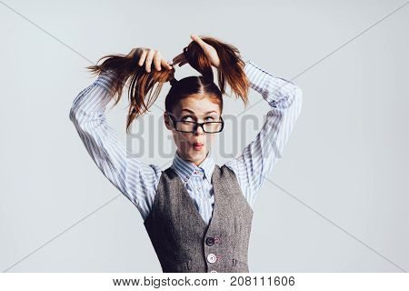 girl secretary wearing glasses keeps herself plaited