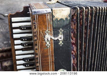 Old accordion. Vintage harmonic. Retro button accordion musical instrument