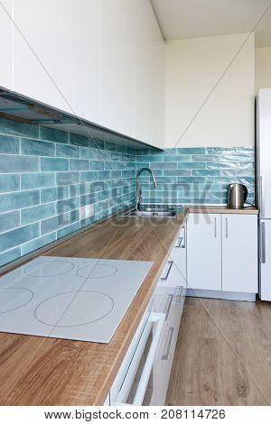 Corner Modern white blue kitchen