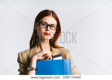 girl secretary in glasses with a serious expression of her face holding a folder
