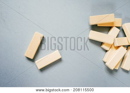a lot of small wooden blocks scattered on the table