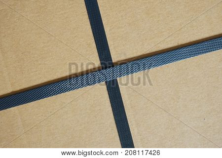 black plastic strap box in cross shape