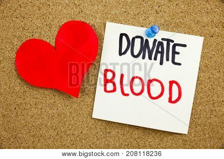 A Yellow Sticky Note Writing, Caption, Inscription Phrase Donate Blood In Black Ext On A Sticky Note