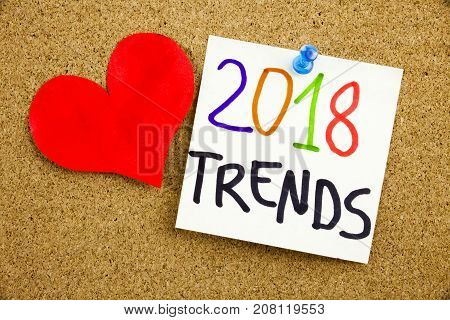 A Yellow Sticky Note Writing, Caption, Inscription Phrase 2018 Trends In Black Ext On A Sticky Note