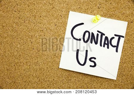 A Yellow Sticky Note Writing, Caption, Inscription Phrase Contact Us In Black Ext On A Sticky Note P