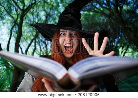 Picture of crying witch in black hat