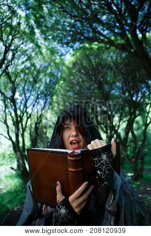Witch reading spell from book