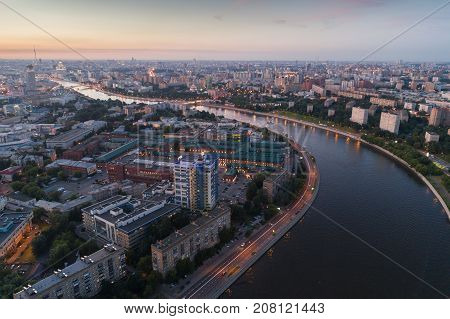 The big city and the river at sunset in the summer. Danilovsky District, Southern Administrative District, Moscow, Russia. Aerial shot with a drone from a altitude