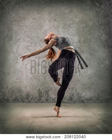 Woman dancer, in beautiful dynamic jump action figure on the grunge background.