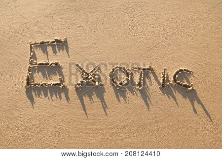 Exotic hand written in the sandy beach