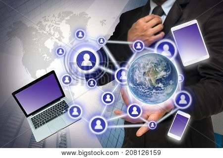 Businessman with show hand posture with the Social media and technology devide on blurred building background Elements of this image furnished. Business network concept, 3D