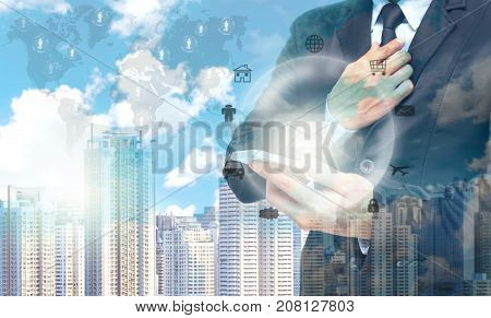 Double exposure of businessman using the tablet for Information technology on world map and cityscape background business conceptElements of this image furnished. 3D illustration
