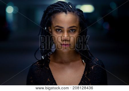 Night Portrait Of A Stylish Young African Woman