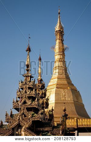 The golden bright stupa of the ancient buddhist Sule Pagoda in the heart of downtown Yangon in Myanmar