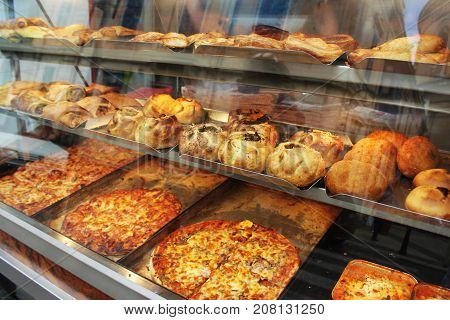 Traditional savoury pastry with filling. Fresh pastizzi and snacks for sale in a pastizzeria. Malta .