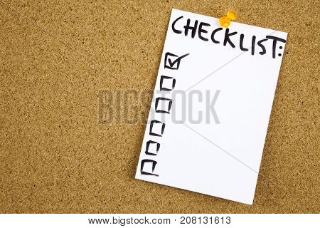 A Yellow Sticky Note Writing, Caption, Inscription Checklist On Colorful Sticky Note In Black Ext On