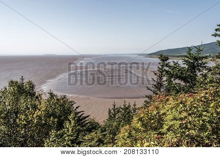 Low Tide Beach On Bay Of Fundy New Brunswick - Canada Brown Colored Water Called Chocolate River