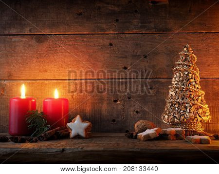 Romantic Christmas background with star shaped cinnamon cookies on a wooden table