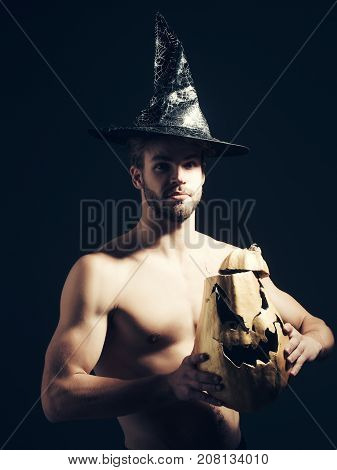Halloween Macho With Muscular Torso, Biceps, Triceps Holding Pumpkin
