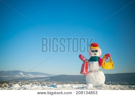 Snowman In Pink Wig, Mittens, Hat, Glasses And Scarf.