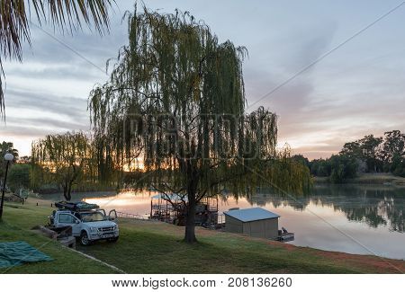 UPINGTON SOUTH AFRICA - JUNE 12 2017: Sunrise at Sakkie se Arkie a holiday resort next to the Orange River at Upington a town in the Northern Cape Province