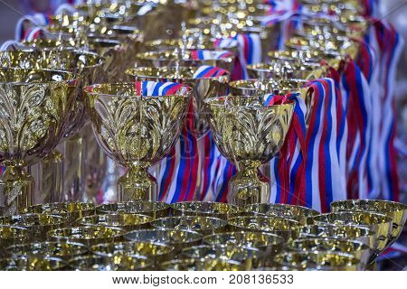 Gold trophies on a table. Gold cup for Award winning
