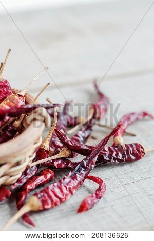 dried chilli in a bowl on wooden.
