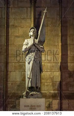 Memorial To Saint Jeanne De Arc At Notre Dame De Paris