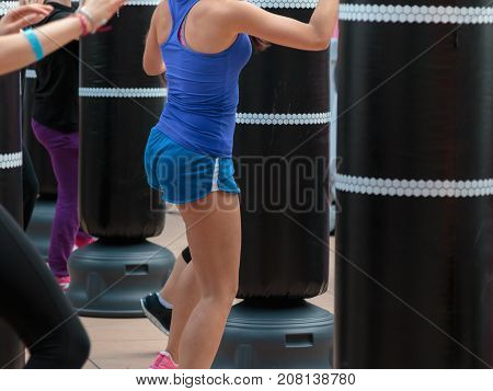 Young Girl in Blue Sportswear: Fitness and Boxing Workout with Punching Bag