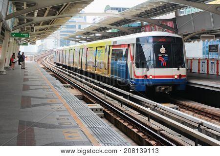 BANGKOK - OCT 30: Travellers board a BTS Skytrain at a city centre station on october 30 2012 in Bangkok Thailand. The Thai capital's BTS rail public transport.