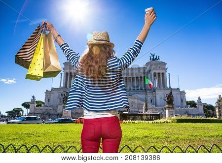 Tourist Woman With Shopping Bags And Coffee Cup Rejoicing