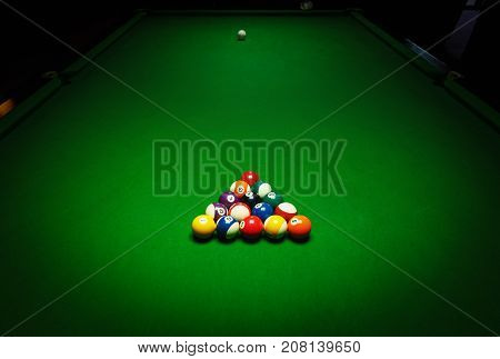Billards pool game. Green cloth table with coloful balls