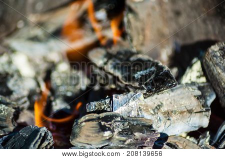 close-up of burning coals black with a small amount of fire