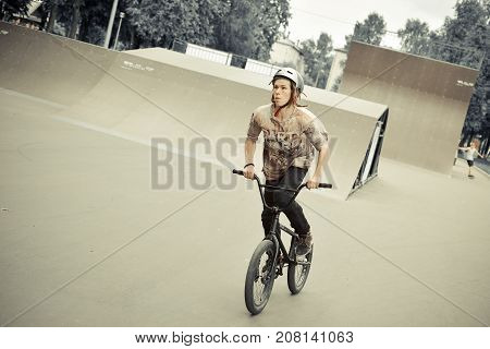 Yoshkar-Ola, Russia - June 26, 2015 Unknown young bicyclist dispersed on bmh in skate park in victory park in Yoshkar-Ola, Mari El, Russia